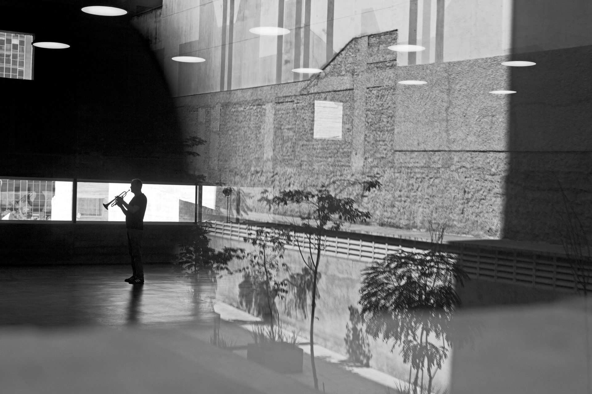 A trumpet player of The deutsche Kammerphilharmonie Bremen is doing his rehearsal in an empty space next to the rehearsal room. The famous orchestra The deutsche Kammerphilharmonie Bremen on its tour in Sao Paulo, Brasil, playing all 9 Beethoven symphonies in 4 days, 1.8.2013 (In Tune – Variations on an Orchestra)